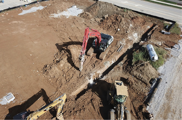 Trench work to install pipe and structures.