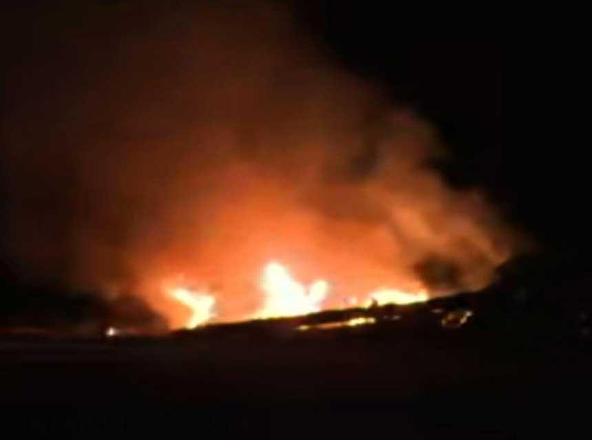 Flames form National Guard helicopter crash