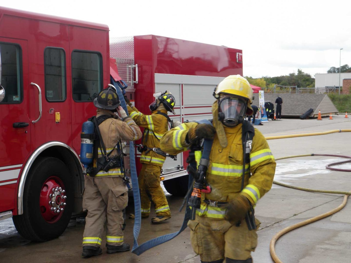 One firefighter will grab the nozzle and start to walk towards the door of the building or to the fire location