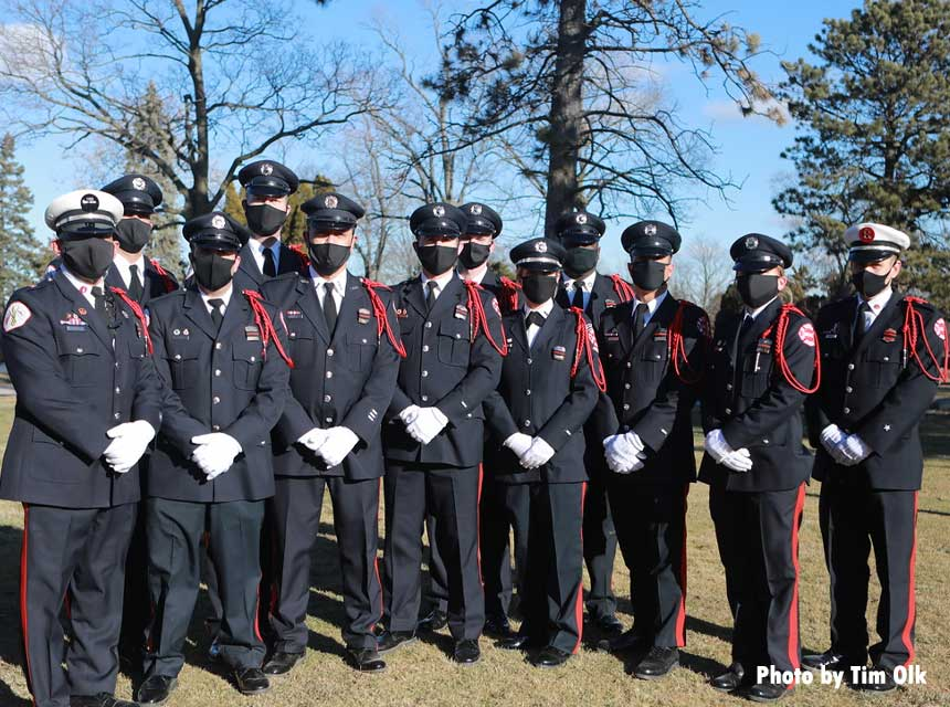 Chicago Fire Department members in masks at the funeral for Paramedic Robert Truevillian