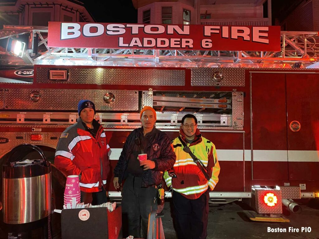 Rehab team in front of Boston Fire Ladder 6