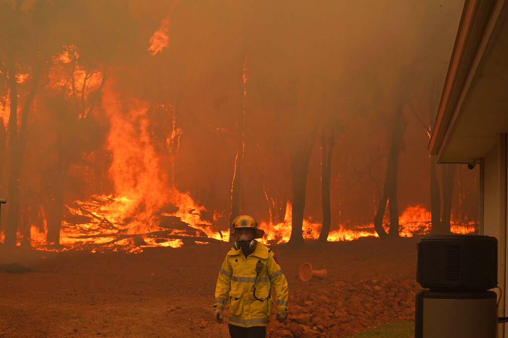 Firefighter at a raging wildfire in Perth, Australia
