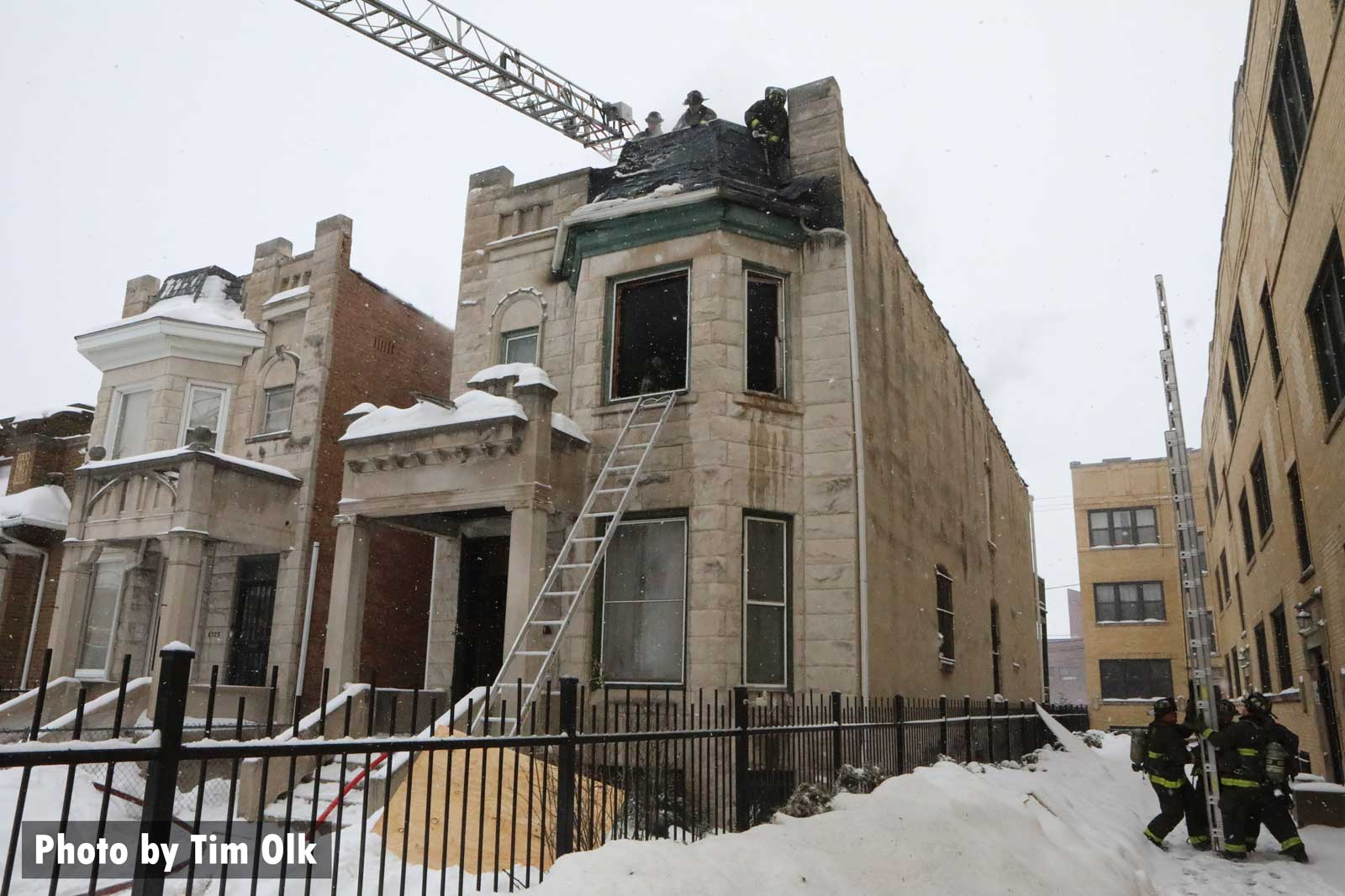 Chicago firefighters laddering a building