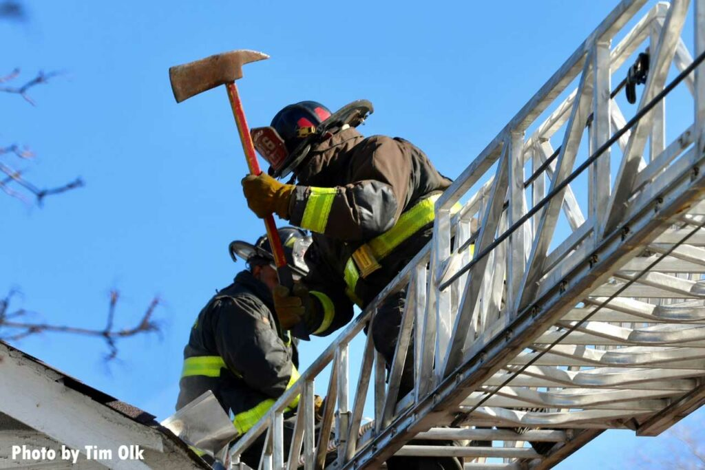 Firefighter on an aerial with an ax in Chicago