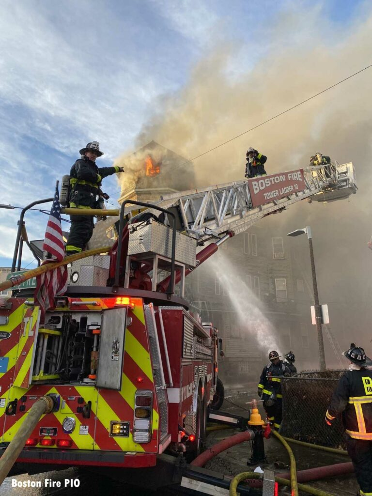Boston firefighters on Tower Ladder at three-alarm fire