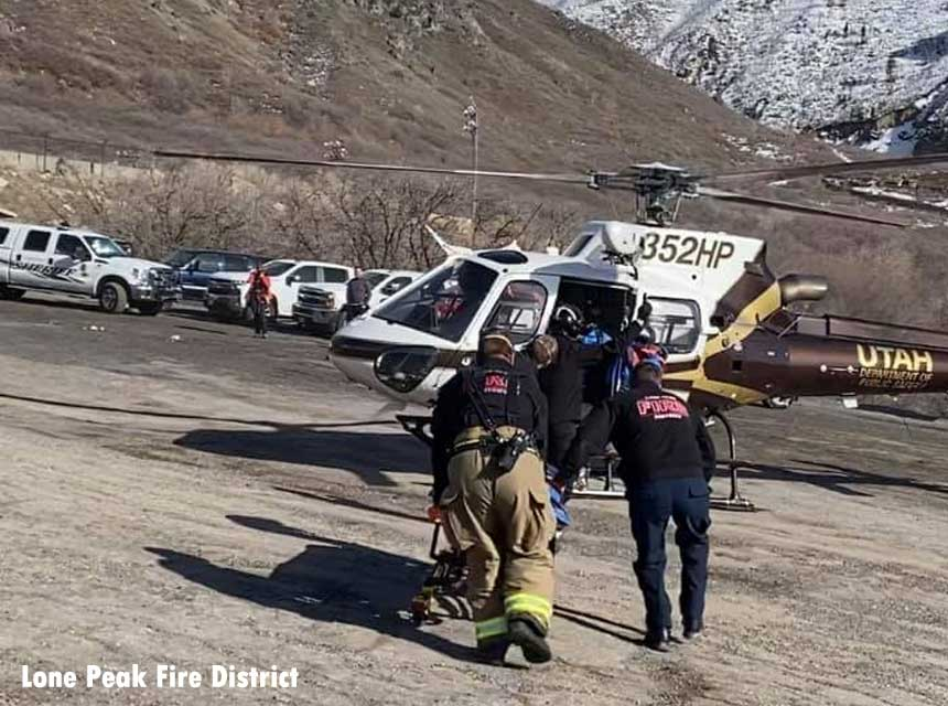 Firefighters transfer patient to helicopter after avalanceh rescue