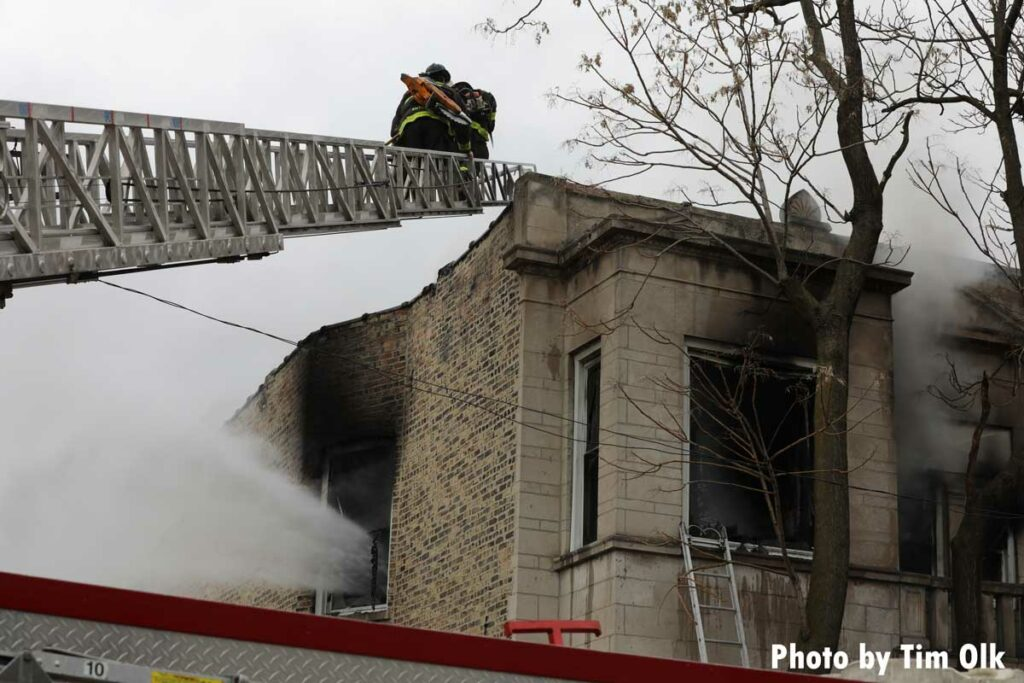 Chicago firefighter on an aerial ladder at fire scene