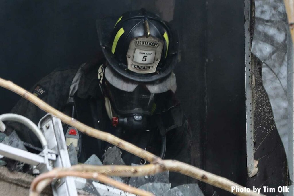 Chicago fire lieutenant in full gear at scene of fire