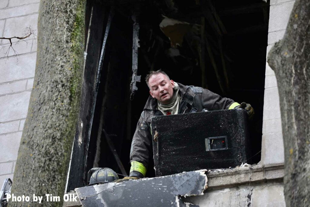 Firefighter puts his head out of a window at Chicago fire