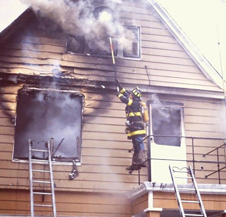 The outside vent firefighter takes the gable window at the right time to relieve conditions in the attic for the engine company attacking the fire.