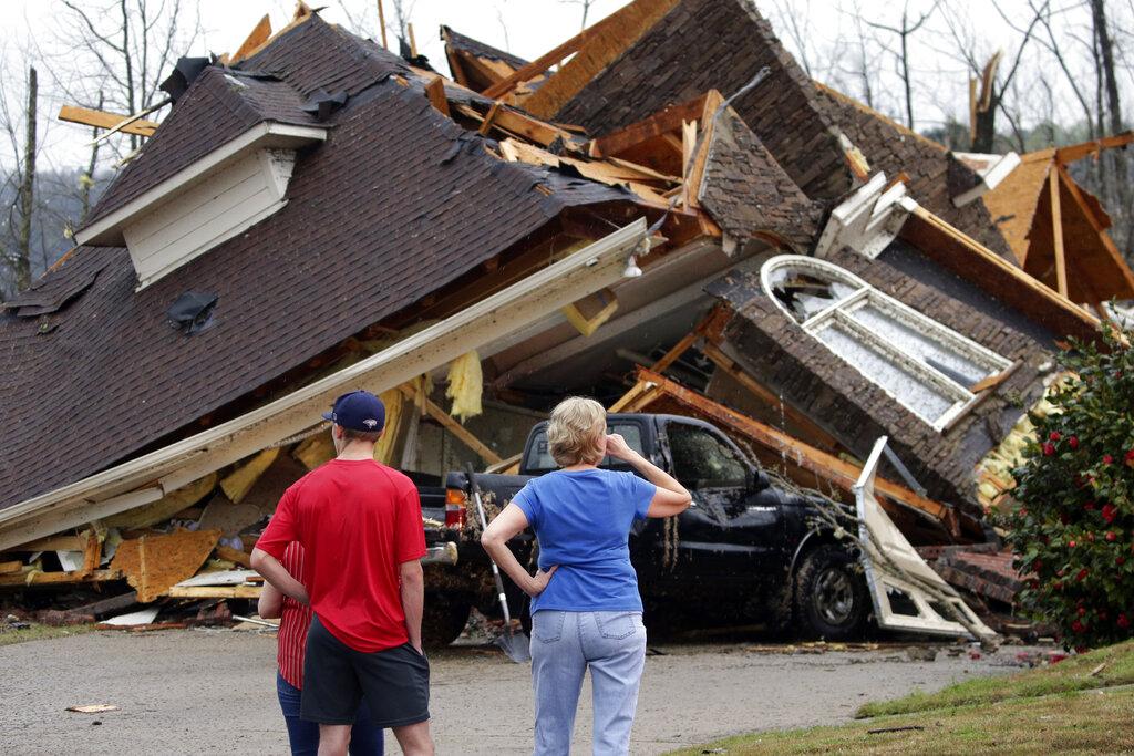 Tornado crushes house