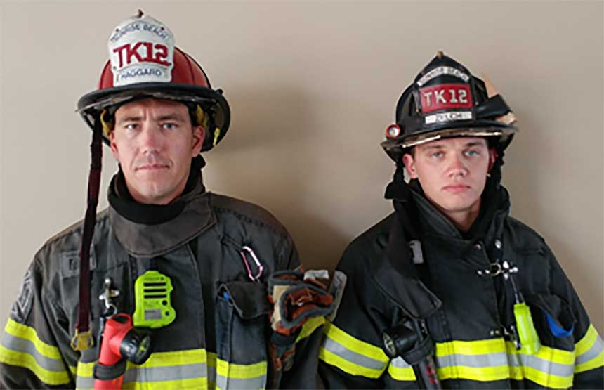 Helmet shield on fire captain and firefighter