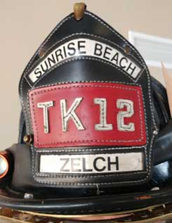 Firefighter helmet shield
