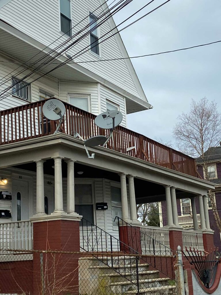TV satellite dishes on a porch