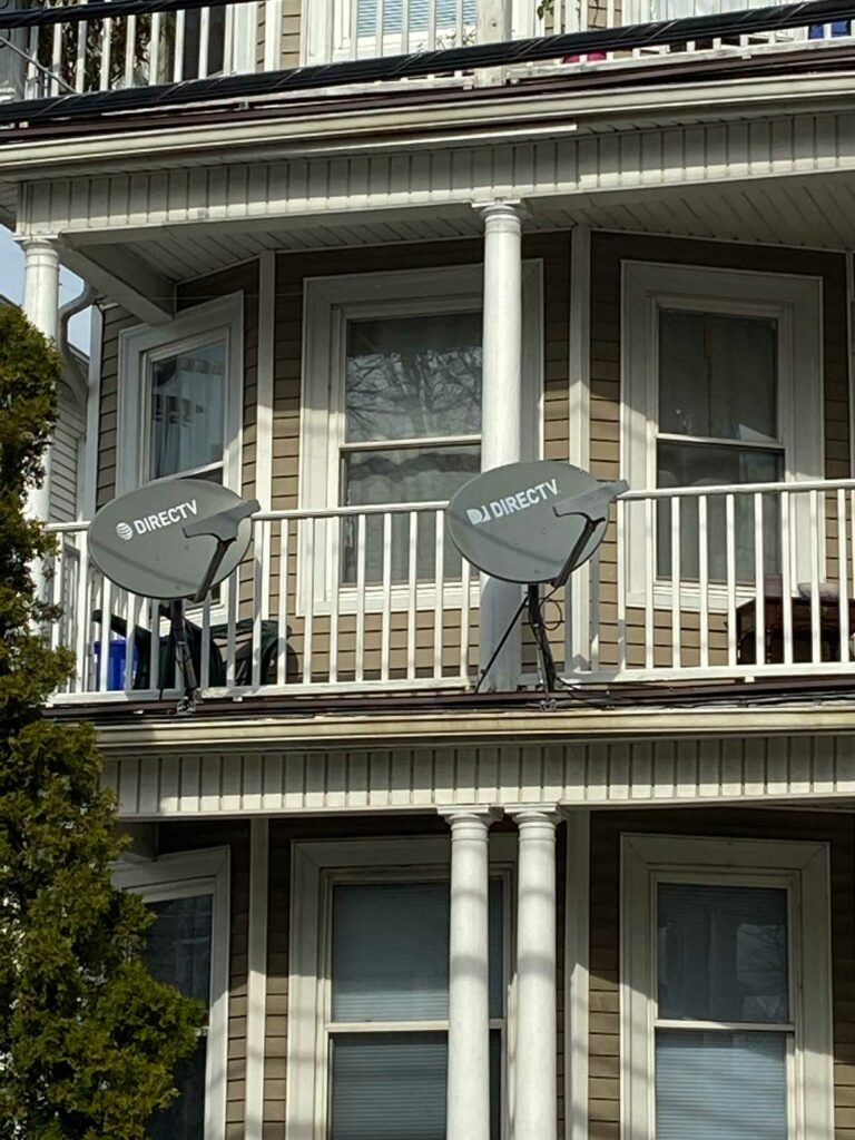 Multiple TV dishes on a porch