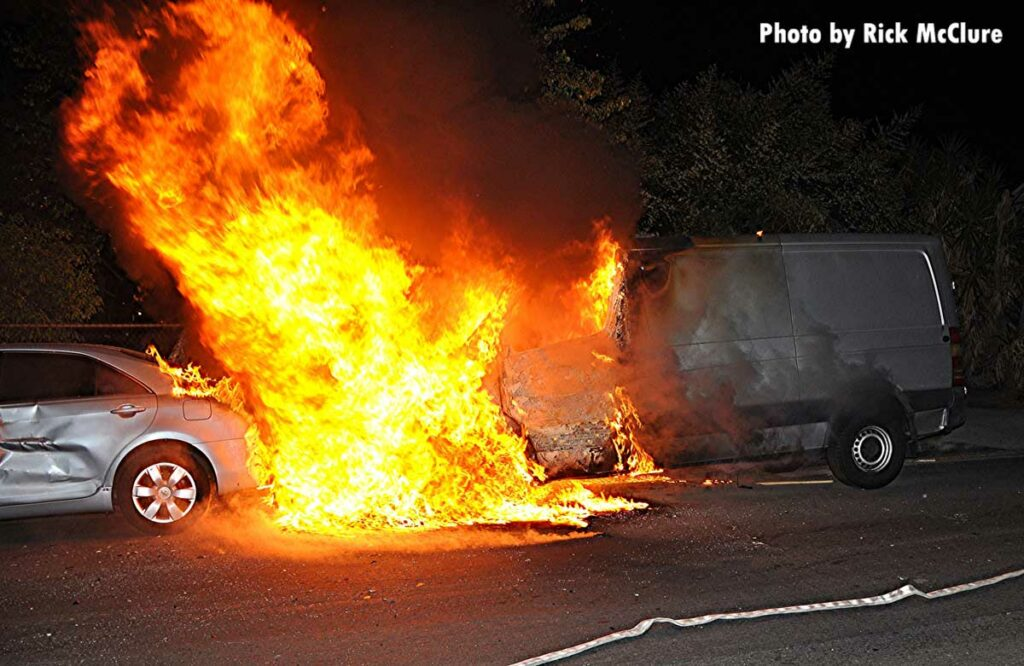 Flames from a burning van spread to a car
