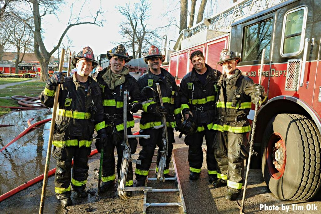 Several Chicago firefighters with equipment at Lafflin fire scene