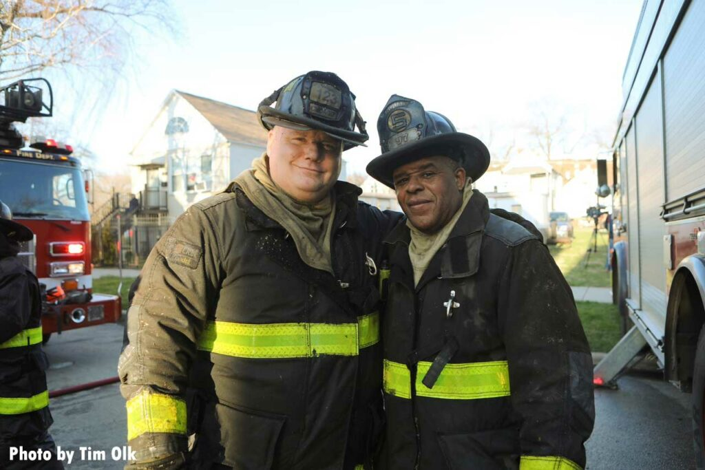 Two Chicago firefighters at fire scene