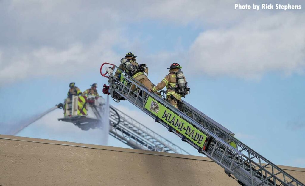 Two tower ladders at work with elevated streams