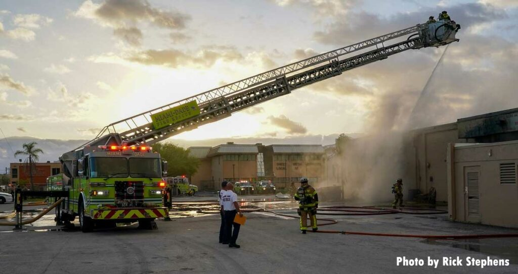 Miami-Dade tower ladder with firefighters in the bucket working the elevated stream