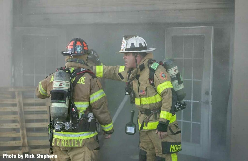 Firefighter consult at the Miami-Dade warehouse fire