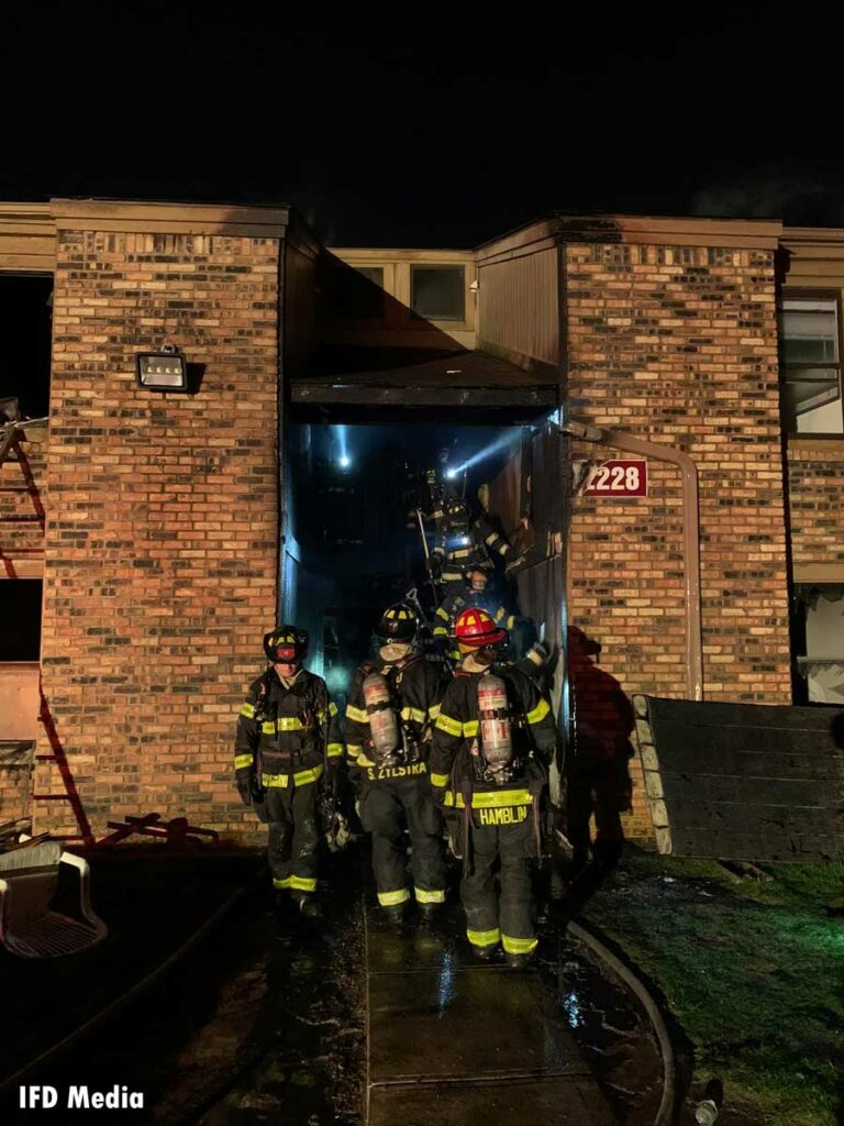 Damage to building as firefighters work at scene of fire in Indianapolis