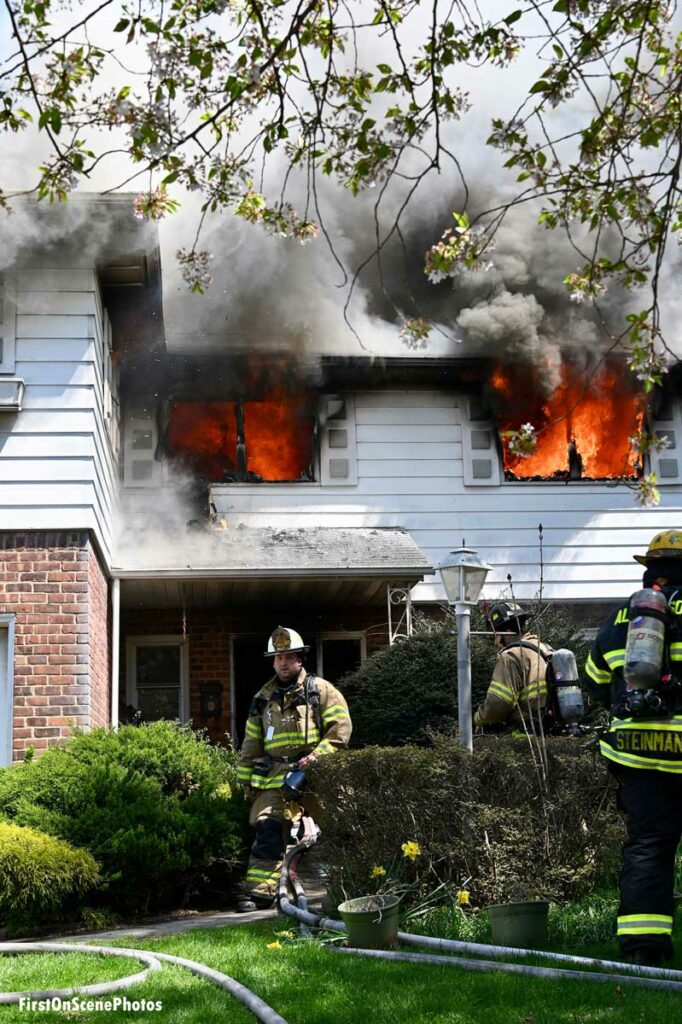 Flames blowing out two second floor windows at a Searington house fire