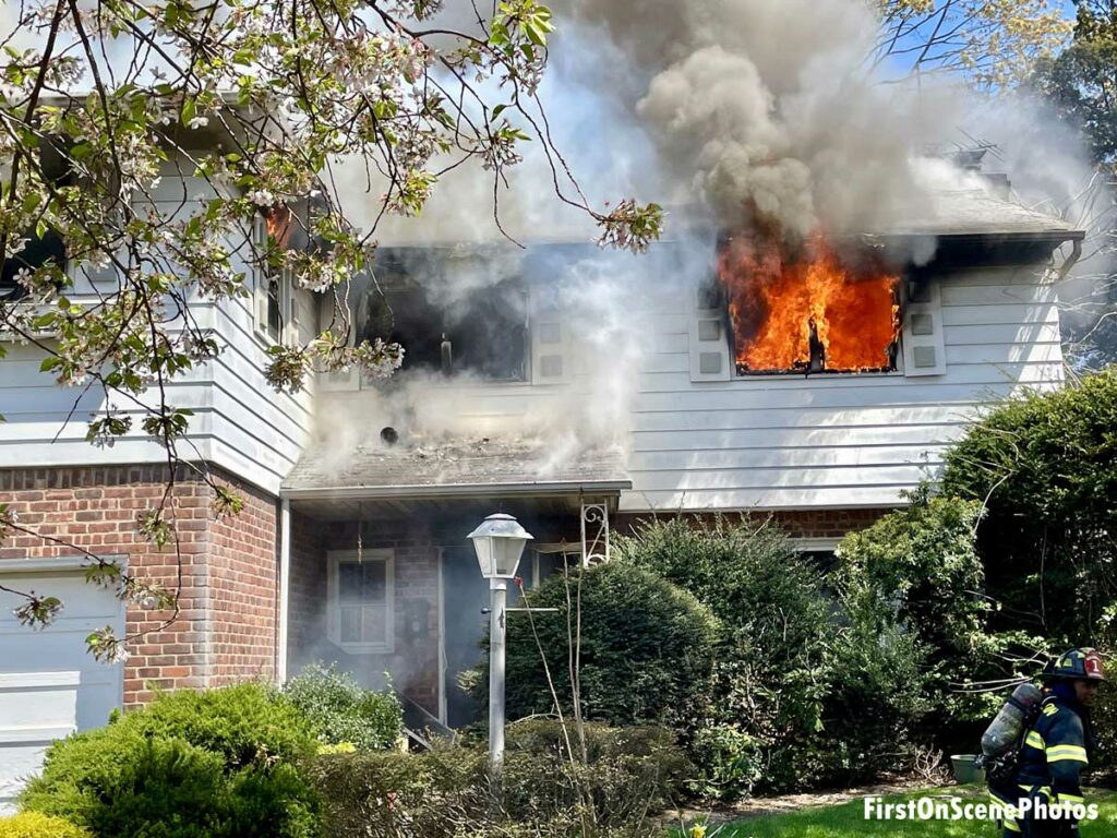 Flames shooting from a home's second floor