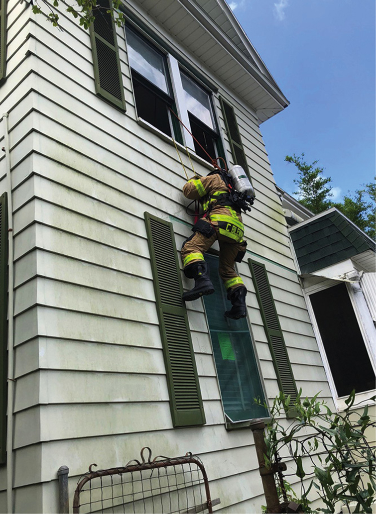 Crews were able to take advantage of a two-story home to practice safety and survival drills, including window bailouts. <em>(Photos by William Townsend unless otherwise noted.)