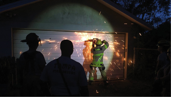 Firefighters were able to make multiple cuts on a metal garage door, which enhanced their power tool skills.