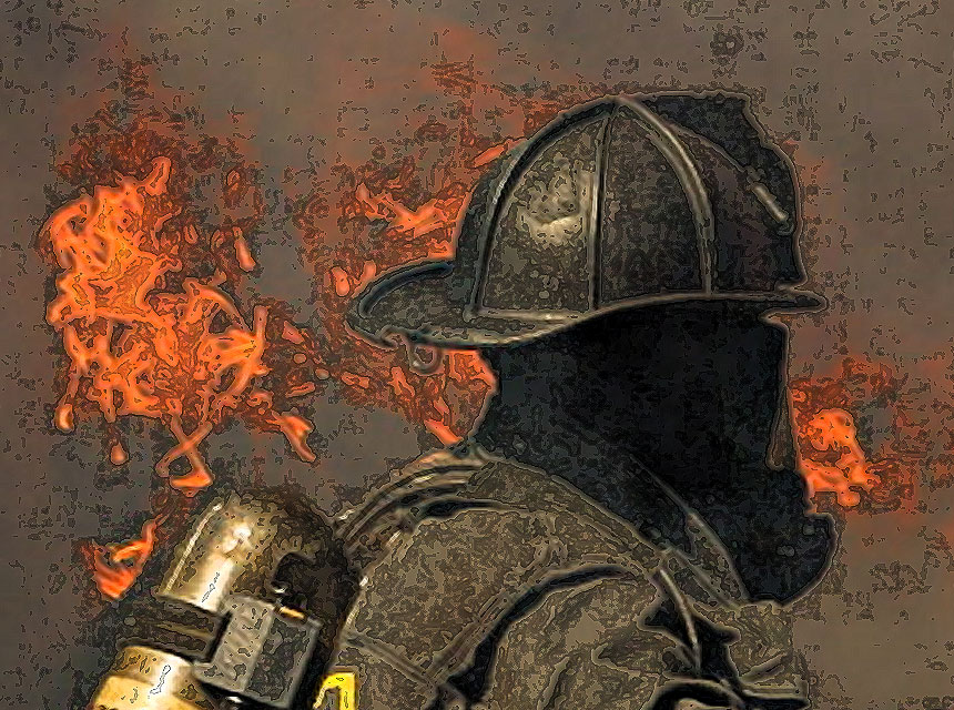 Firefighter in full gear facing flames