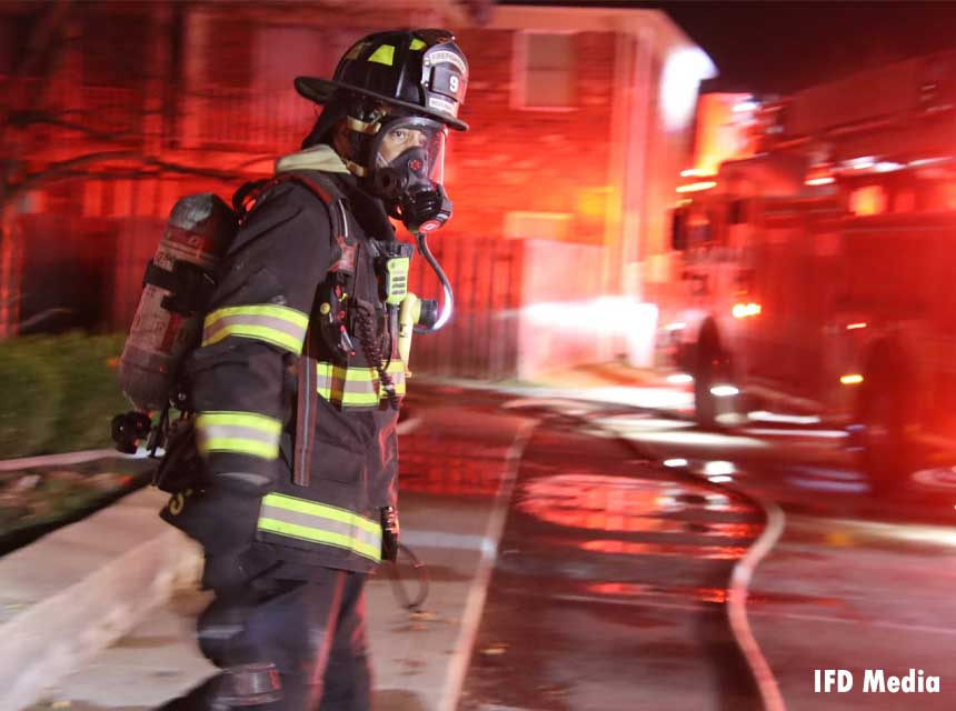 Indianapolis firefighter responding to the scene of a fire in March 2021