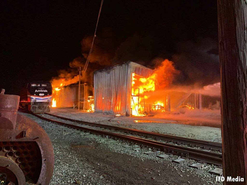 Storage buildings near rail property fully involved in fire in Indianapolis