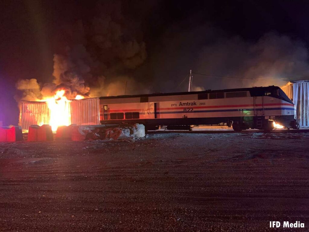Train and fire burning in Amtrak storage buildings