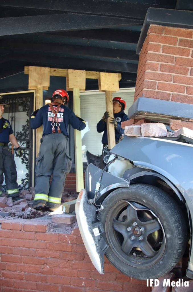 Firefighters use the wooden system to shore up the porch