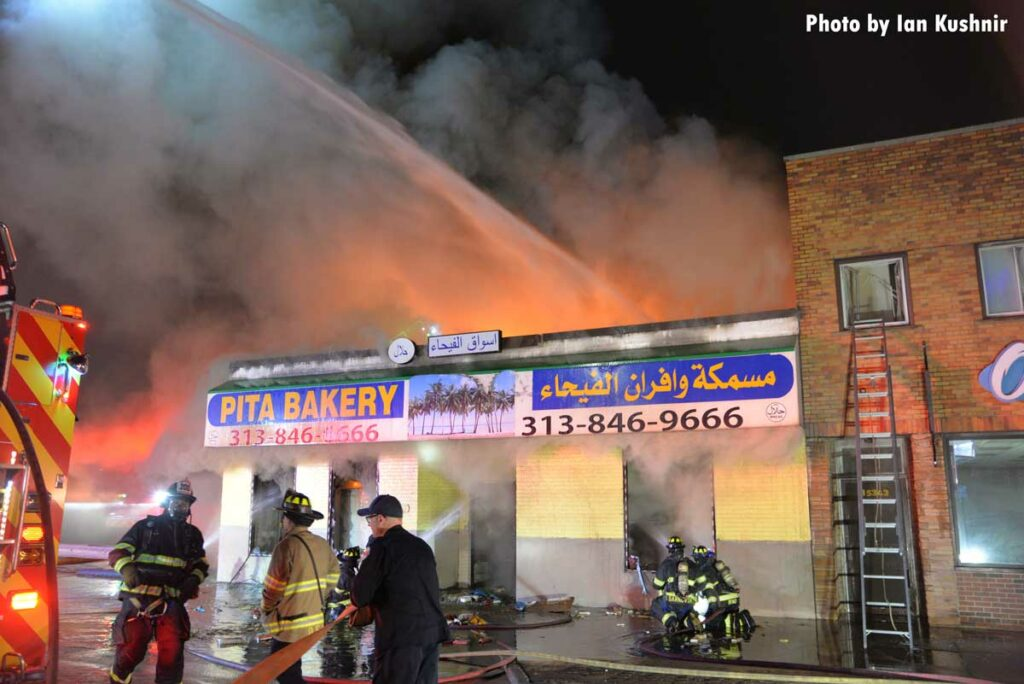 Firefighter use an elevated master stream on a fire at a bakery in Dearborn, Michigan