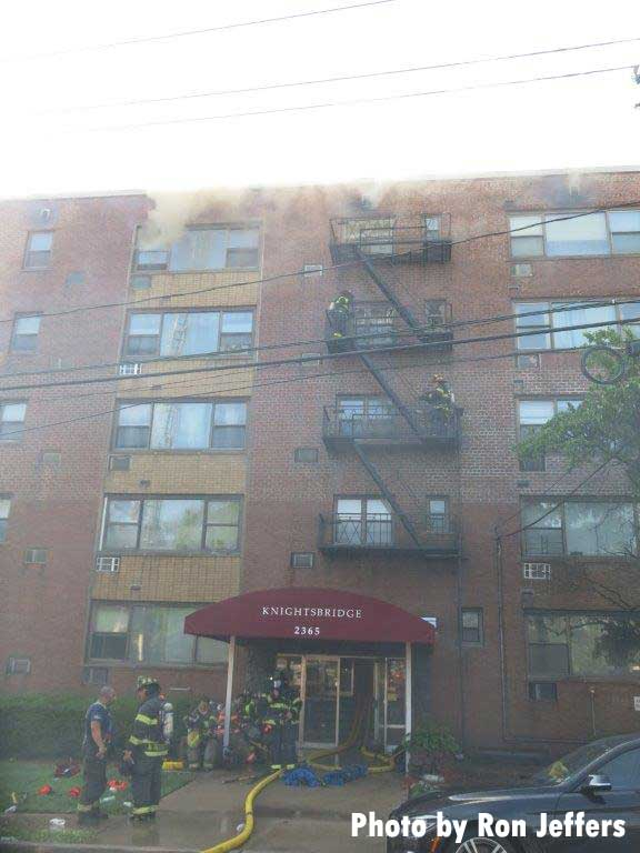 Firefighters and hoselines at apartment fire in Fort Lee, New Jersey