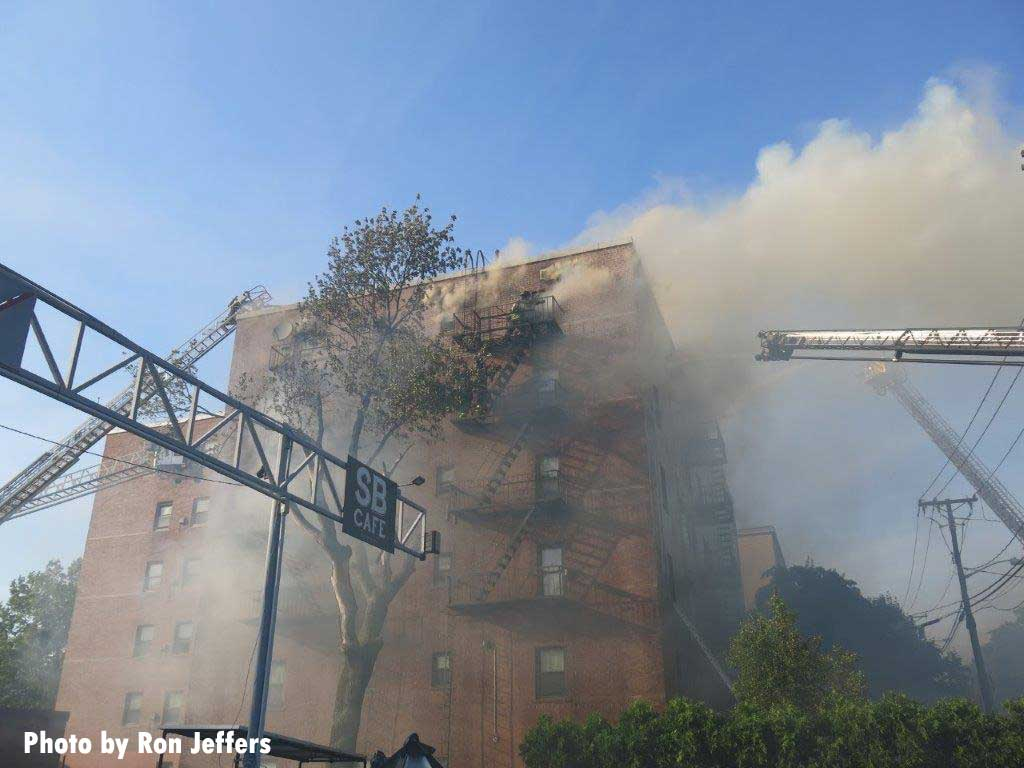 Firefighter and aerials at Fort Lee apartment fire