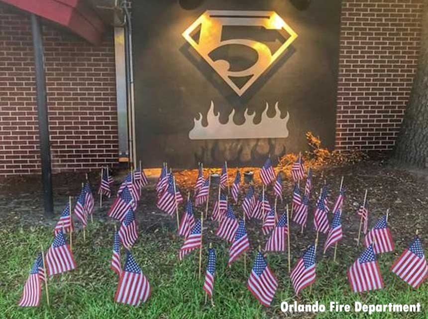 In 2019, the Orlando Fire Department honors those slain and injured in the Pulse nightclub shooting with flags outside of Station 5.