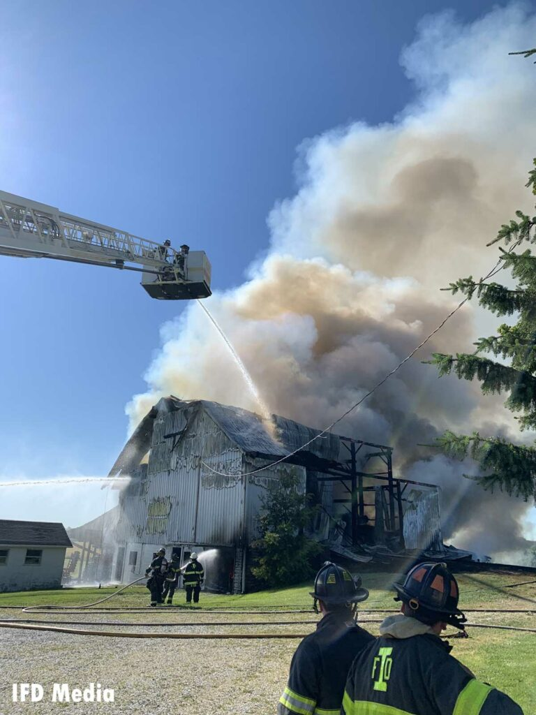 Firefighters and aerial device operating at Indiana barn fire
