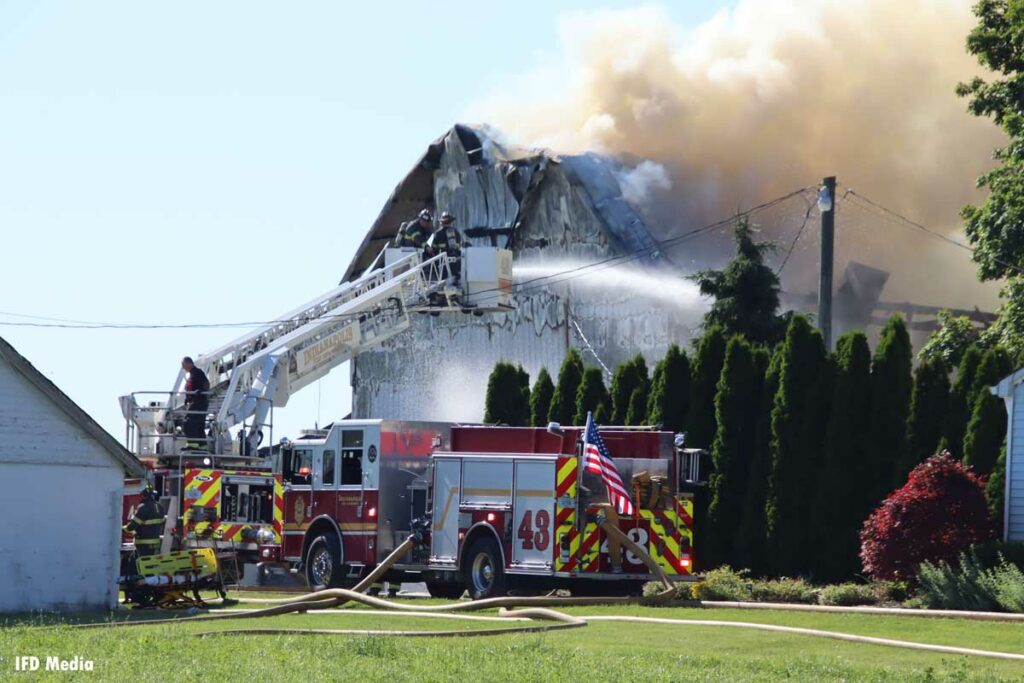 Indianapolis Fire Department crews at scene of barn fire