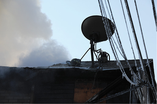 Conditions became so bad so fast that crews had to bail off the roof, leaving behind their equipment and tools.