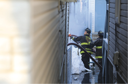 """A view from the """"gangway"""" with water now coming up high to the firefighters."""