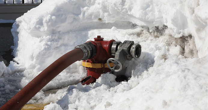 Snow accumulation around a fire hydrant. This is a glimpse of the conditions that crews had to overcome to bring this fire under control.