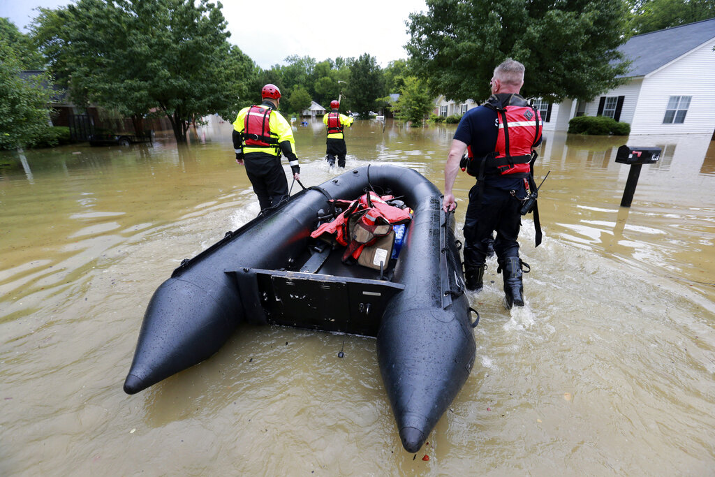 Members of the Tupelo Fire Department assist during flooding