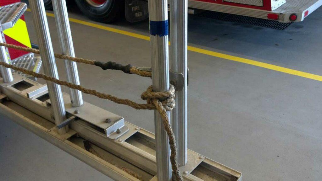 Halyard tied around bottom rung of ground ladder