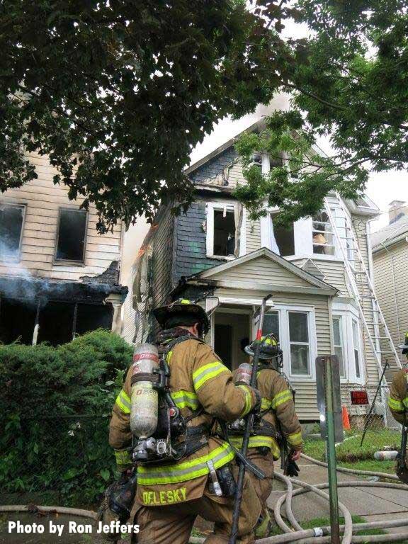 Firefighters outside a five-alarm fire in Kearny, New Jersey