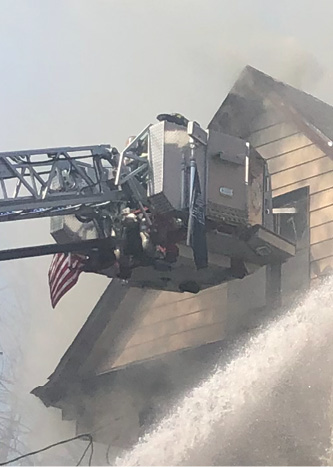 Use a tower ladder stream to knock down a fire in an attic or hydraulically overhaul the roof. If you use it to remove roof sheathing, inform all units on the fireground to maintain a safe distance from the building and be aware of flying debris.