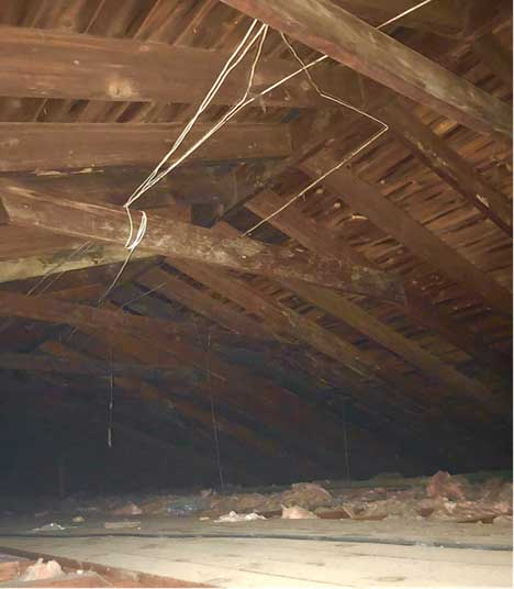An unfinished attic space