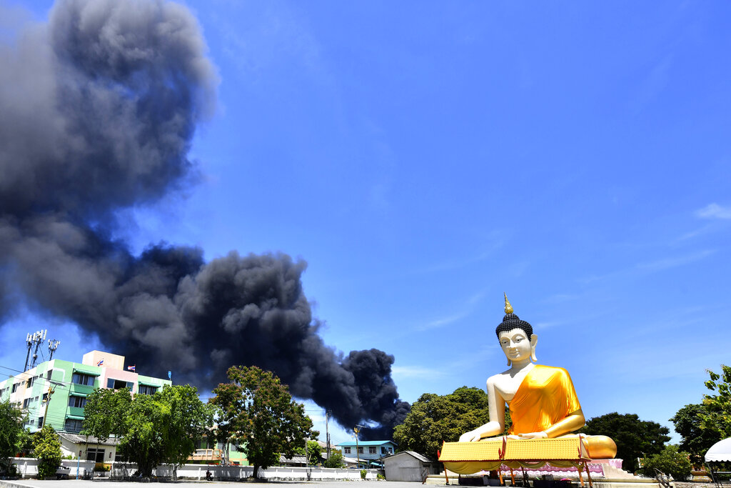 Thailand factory fire with black plume of smoke